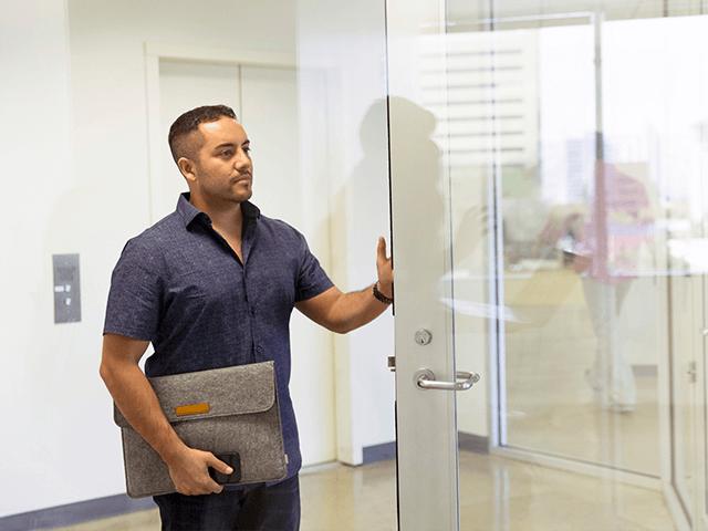 man-standing-next-to-glass-door-1251842.png